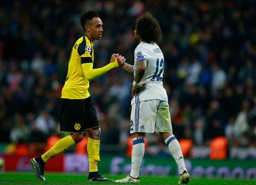 MADRID, SPAIN - DECEMBER 07: Pierre-Emerick Aubameyang of Borussia Dortmund (L) and Marcelo of Real Madrid (R) embrace after the final whistle during the UEFA Champions League Group F match between Real Madrid CF and Borussia Dortmund at the Bernabeu on December 7, 2016 in Madrid, Spain.  (Photo by Gonzalo Arroyo Moreno/Getty Images)