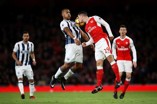 LONDON, ENGLAND - DECEMBER 26:  Granit Xhaka of Arsenal jumps for the ball with Jose Salomon Rondon of West Bromwich Albion during the Premier League match between Arsenal and West Bromwich Albion at Emirates Stadium on December 26, 2016 in London, England.  (Photo by Julian Finney/Getty Images)
