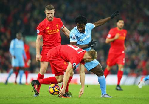 LIVERPOOL, ENGLAND - DECEMBER 27:  Wifried Bony of Stoke City battles with Jordan Henderson and Ragnar Klavan of Liverpool during the Premier League match between Liverpool and Stoke City at Anfield on December 27, 2016 in Liverpool, England.  (Photo by Alex Livesey/Getty Images)
