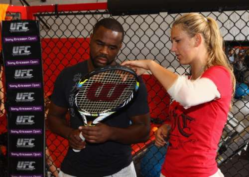 MIAMI, FL - MARCH 21:  Victoria Azarenka of Belarus poses for photographs with former UFC light heavyweight champion 'Suga' Rashad Evans of the USA  at the MMA Masters Academy on March 21, 2012 in Miami, Florida.  (Photo by Clive Brunskill/Getty Images)