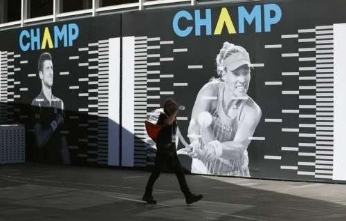 A man walks past boards displaying current Australian Open champions Novak Djokovic and Angelique Kerber, ahead of the Australian Open tennis tournament, in Melbourne, Australia January 15, 2017. REUTERS/Issei Kato