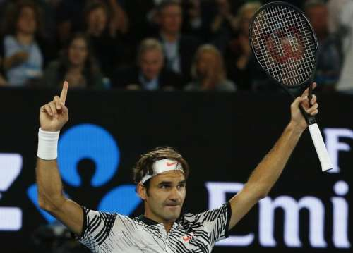 Tennis - Australian Open - Melbourne Park, Melbourne, Australia - 26/1/17 Switzerland's Roger Federer celebrates winning his Men's singles semi-final match against Switzerland's Stan Wawrinka. REUTERS/Edgar Su