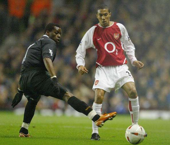 LONDON - DECEMBER 2:  Henri Camara of Wolverhampton Wanderers tries to tackle Gael Clichy of during the Carling Cup fourth round match between Arsenal and Wolverhampton Wanderers at Highbury on December 2, 2003 in London.  (Photo by Clive Mason/Getty Images)