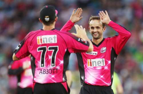 SYDNEY, AUSTRALIA - JANUARY 25:  Sean Abbott of the Sixers celebrates with team mate Nathan Lyon after taking a catch to dismiss Mike Hussey of the Thunder during the Big Bash League match between Sydney Thunder and the Sydney Sixers at ANZ Stadium on January 25, 2014 in Sydney, Australia.  (Photo by Mark Metcalfe/Getty Images)