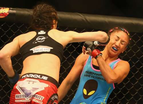 DALLAS, TX - MARCH 14:  (L-R) Joanna Jedrzejczyk fights with  Carla Esparza in the Women's Strawweight bout during the UFC 185 event at American Airlines Center on March 14, 2015 in Dallas, Texas.  (Photo by Ronald Martinez/Getty Images)