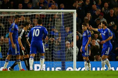 LONDON, ENGLAND - DECEMBER 26:  Oscar of Chelsea is consoled by team-mate Branislav Ivanovic after he slipped taking a penalty and missed the target during the Barclays Premier League match between Chelsea and Watford at Stamford Bridge on December 26, 2015 in London, England.  (Photo by Richard Heathcote/Getty Images)