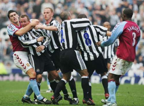 NEWCASTLE, ENGLAND - APRIL 2 :  Gareth Barry of Aston Villa pulls apart the fighting Lee Bowyer and Kieron Dyer of Newcastle during the FA Barclays Premiership match between Newcastle United and Aston Villa at St James Park on April 2, 2005 in Newcastle, England.  (Photo by Laurence Griffiths/Getty Images)