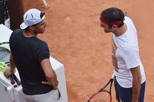 ROME, ITALY - MAY 09:  Roger Federer of Switzerland speaks to Rafael Nadal of Spain ahead of a training session on Day Two of The Internazionali BNL d'Italia 2016 on May 09, 2016 in Rome, Italy.  (Photo by Dennis Grombkowski/Getty Images)