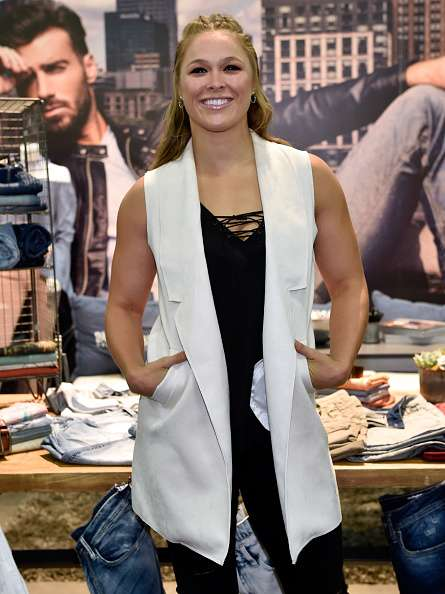 LAS VEGAS, NV - AUGUST 15:  Buffalo David Bitton Brand Ambassador Ronda Rousey attends the Buffalo David Bitton booth during Project Vegas at the Mandalay Bay Convention Center on August 15, 2016 in Las Vegas, Nevada.  (Photo by David Becker/Getty Images for Buffalo David Bitton)