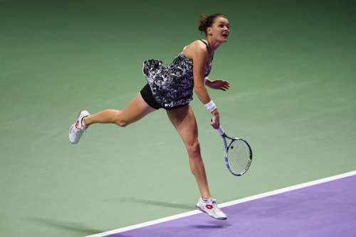 SINGAPORE - OCTOBER 29:  Agnieszka Radwanska of Poland serves in her singles semi-final match against Angelique Kerber of Germany during day 7 of the BNP Paribas WTA Finals Singapore at Singapore Sports Hub on October 29, 2016 in Singapore.  (Photo by Clive Brunskill/Getty Images)