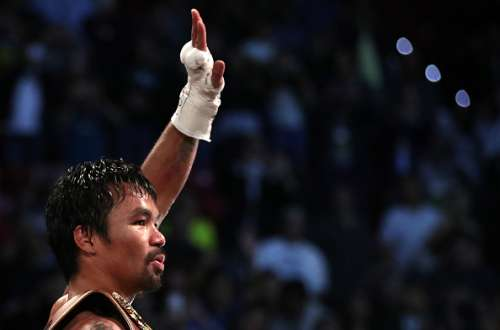 LAS VEGAS, NV - NOVEMBER 05:   Manny Pacquiao of the Philippines celebrates after his unanimous-decision victory over Jessie Vargas at the Thomas & Mack Center on November 5, 2016 in Las Vegas, Nevada.  Pacquiao won the WBO welterweight championship.  (Photo by Christian Petersen/Getty Images)