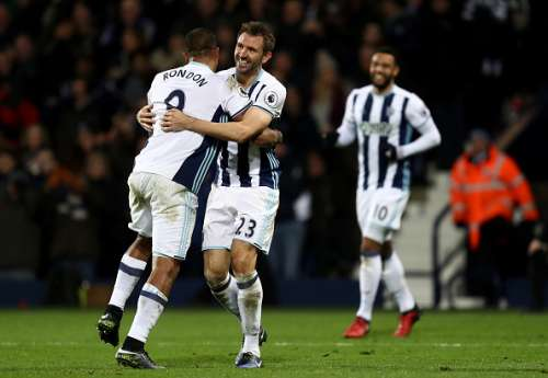 WEST BROMWICH, ENGLAND - JANUARY 02: Gareth McAuley of West Bromwich Albion (C) celebrates scoring his sides second goal with Jose Salomon Rondon of West Bromwich Albion during the Premier League match between West Bromwich Albion and Hull City at The Hawthorns on January 2, 2017 in West Bromwich, England.  (Photo by Julian Finney/Getty Images)