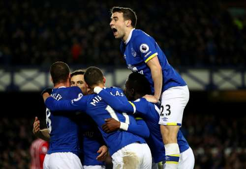 LIVERPOOL, ENGLAND - JANUARY 02:  Leighton Baines of Everton is mobbed by team mates including Seamus Coleman (top) after scoring his team's second goal during the Premier League match between Everton and Southampton at Goodison Park on January 2, 2017 in Liverpool, England.  (Photo by Clive Brunskill/Getty Images)