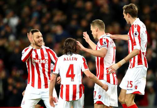 STOKE ON TRENT, ENGLAND - JANUARY 03: Ryan Shawcross (2nd R) of Stoke City celebrates scoring the opening goal with his team mates Marko Arnautovic (1st L), Joe Allen (2nd L) and Peter Crouch (1st R) during the Premier League match between Stoke City and Watford at Bet365 Stadium on January 3, 2017 in Stoke on Trent, England.  (Photo by Clive Brunskill/Getty Images)