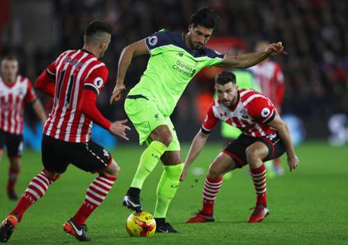 SOUTHAMPTON, ENGLAND - JANUARY 11:  Emre Can of Liverpool is watched by Dusan Tadic (11) and Jay Rodriguez of Southampton (9) during the EFL Cup semi-final first leg match between Southampton and Liverpool at St Mary's Stadium on January 11, 2017 in Southampton, England.  (Photo by Ian Walton/Getty Images)
