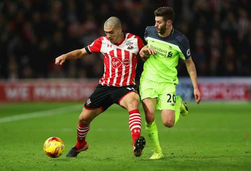 SOUTHAMPTON, ENGLAND - JANUARY 11:  Oriol Romeu of Southampton holds off Adam Lallana of Liverpool during the EFL Cup semi-final first leg match between Southampton and Liverpool at St Mary's Stadium on January 11, 2017 in Southampton, England.  (Photo by Clive Rose/Getty Images)