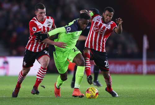 SOUTHAMPTON, ENGLAND - JANUARY 11:  Divock Origi of Liverpool battles with Pierre-Emile Hojbjerg (L) and Ryan Bertrand of Southampton during the EFL Cup semi-final first leg match between Southampton and Liverpool at St Mary's Stadium on January 11, 2017 in Southampton, England.  (Photo by Ian Walton/Getty Images)