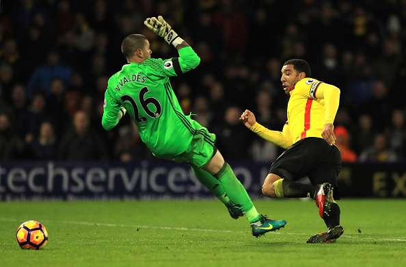 WATFORD, ENGLAND - JANUARY 14: Troy Deeney of Watford (R) shoots and Victor Valdes of Middlesbrough (L) attempts to save during the Premier League match between Watford and Middlesbrough at Vicarage Road on January 14, 2017 in Watford, England.  (Photo by Richard Heathcote/Getty Images)