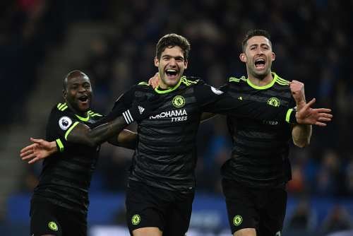 LEICESTER, ENGLAND - JANUARY 14:  Marcos Alonso of Chelsea celebrates his second goal alongside Victor Moses (L) and Gary Cahill (R) during the Premier League match between Leicester City and Chelsea at The King Power Stadium on January 14, 2017 in Leicester, England.  (Photo by Laurence Griffiths/Getty Images)