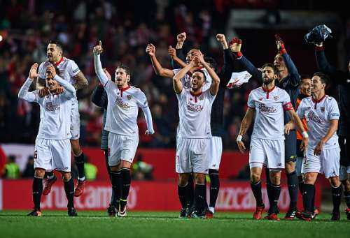SEVILLE, SPAIN - JANUARY 15:  (L-R) Adil Rami, Victor Machin Perez 'Vitolo',  Stevan Jovetic and Sergio Escudero of Sevilla FC celebrates after winning the match against Real Madrid CF during the La Liga match between Sevilla FC and Real Madrid CF at Estadio Ramon Sanchez Pizjuan on January 15, 2017 in Seville, Spain.  (Photo by Aitor Alcalde/Getty Images)