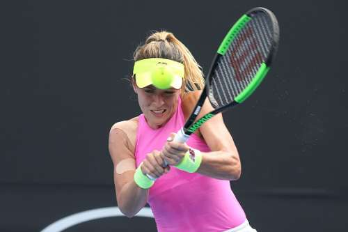 MELBOURNE, AUSTRALIA - JANUARY 17:  Nicole Gibbs of the United States plays a backhand in her first round match against Timea Babos of Hungary on day two of the 2017 Australian Open at Melbourne Park on January 17, 2017 in Melbourne, Australia.  (Photo by Pat Scala/Getty Images)