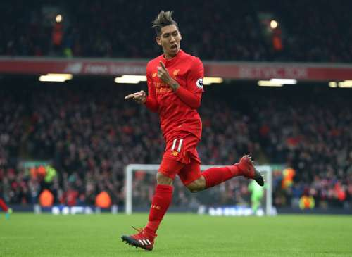 LIVERPOOL, ENGLAND - JANUARY 21: Roberto Firmino of Liverpool celebrates scoring his sides second goal during the Premier League match between Liverpool and Swansea City at Anfield on January 21, 2017 in Liverpool, England.  (Photo by Julian Finney/Getty Images)