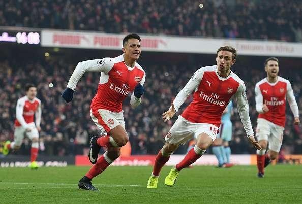 LONDON, ENGLAND - JANUARY 22:  Alexis Sanchez of Arsenal celebrates scoring his team
