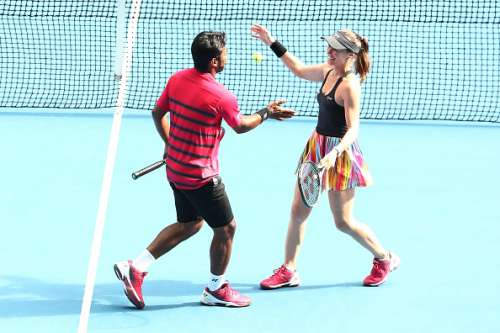 MELBOURNE, AUSTRALIA - JANUARY 23:  Martina Hingis of Switzerland and Leander Paes of India celebrate winning their second round mixed doubles match against Casey Dellacqua and Matt Reid of Australia on day eight of the 2017 Australian Open at Melbourne Park on January 23, 2017 in Melbourne, Australia.  (Photo by Scott Barbour/Getty Images)