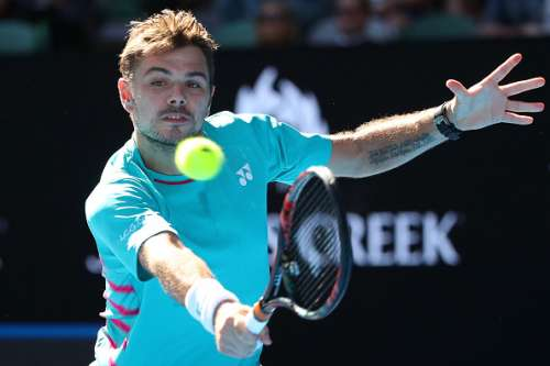 MELBOURNE, AUSTRALIA - JANUARY 24:  Stan Wawrinka of Switzerland plays a backhand in his quarterfinal match against Jo-Wilfried Tsonga of France on day nine of the 2017 Australian Open at Melbourne Park on January 24, 2017 in Melbourne, Australia.  (Photo by Cameron Spencer/Getty Images)