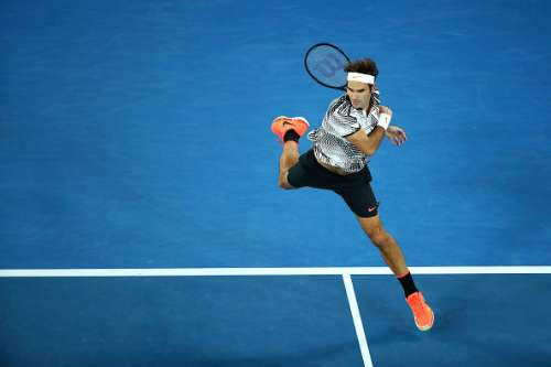 MELBOURNE, AUSTRALIA - JANUARY 26:  Roger Federer of Switzerland plays a forehand in his semifinal match against Stan Wawrinka of Switzerland on day 11 of the 2017 Australian Open at Melbourne Park on January 26, 2017 in Melbourne, Australia.  (Photo by Cameron Spencer/Getty Images)