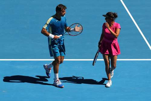 MELBOURNE, AUSTRALIA - JANUARY 27:  Sania Mirza of India and Ivan Dodig of Croatia talk tactics against Samantha Stosur and Sam Groth of Australia in their mixed doubles semifinal match on day 12 of the 2017 Australian Open at Melbourne Park on January 27, 2017 in Melbourne, Australia.  (Photo by Cameron Spencer/Getty Images)
