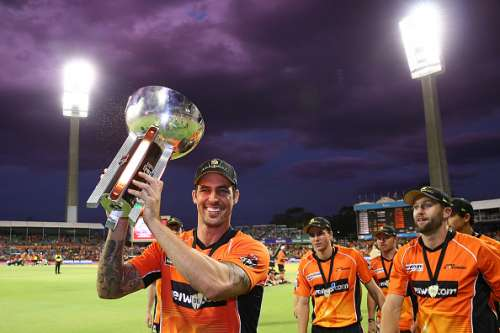 PERTH, AUSTRALIA - JANUARY 28:  Mitchell Johnson of the Scorchers carries the BBL trophy after winning the Big Bash League match between the Perth Scorchers and the Sydney Sixers at WACA on January 28, 2017 in Perth, Australia.  (Photo by Paul Kane/Getty Images)