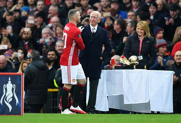 MANCHESTER, ENGLAND - JANUARY 29:  Wayne Rooney of Manchester United is presented with an award for becoming the club