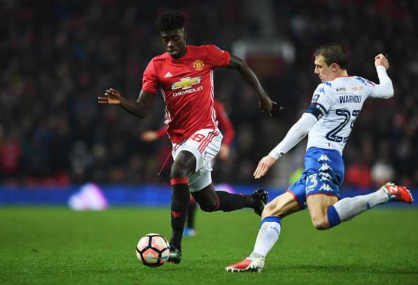 MANCHESTER, ENGLAND - JANUARY 29:  Axel Tuanzebe of Manchester United is tackled by Stephen Warnock of Wigan Athletic during the Emirates FA Cup Fourth round match between Manchester United and Wigan Athletic at Old Trafford on January 29, 2017 in Manchester, England.  (Photo by Gareth Copley/Getty Images)