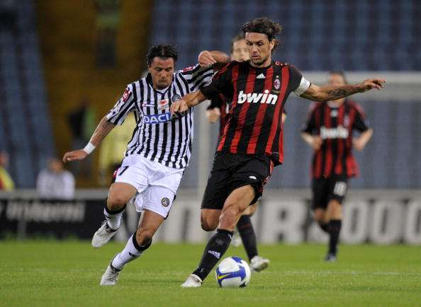 UDINE, ITALY - MAY 05:  Simone Pepe of Udinese is held off by Paolo Maldini of AC Milan in action during the Serie A match between Udinese and AC Milan at the Stadio Friuli on May 16, 2009 in Udine, Italy. (Photo by New Press/Getty Images)