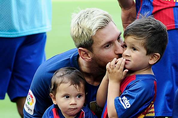 Lionel Messi with his sons Mateo and Thiago