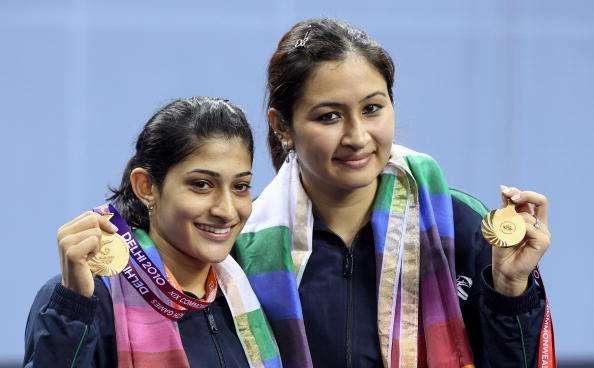 DELHI, INDIA - OCTOBER 14:  Jawala Gutta and Ashwini Machimanda of India celebrates after winning a gold medal against  Shinta Mulia Sari and Lei Yao of China in the women