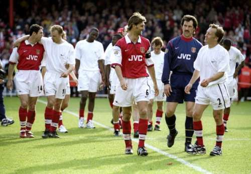 16 May 1999:  Tony Adams, David Seaman and Lee Dixon of Arsenal console each other after the FA Carling Premiership match against Aston Villa played at Highbury in London, England.  The match finished in a 1-0 victory for Arsenal, however, they were unable to clinch the Premiership title. \ Mandatory Credit: Ross Kinnaird /Allsport