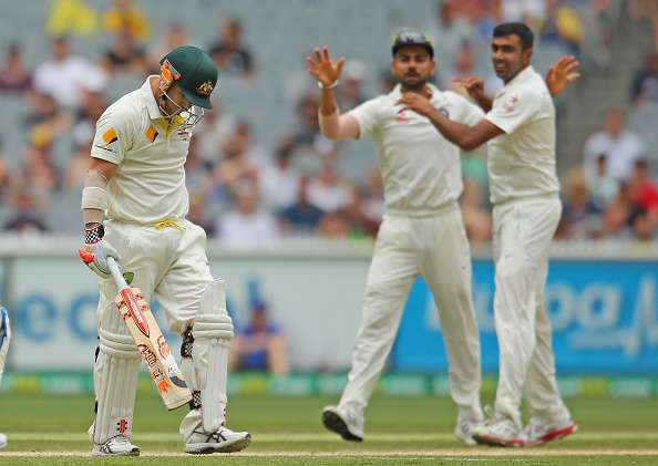 MELBOURNE, AUSTRALIA - DECEMBER 29:  Ravichandran Ashwin of India celebrates with Virat Kohli after dismissing David Warner of Australia during day four of the Third Test match between Australia and India at Melbourne Cricket Ground on December 29, 2014 in Melbourne, Australia..  (Photo by Scott Barbour/Getty Images)