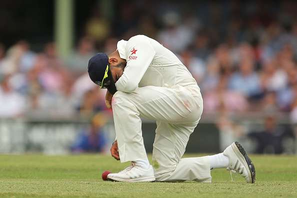 SYDNEY, AUSTRALIA - JANUARY 09: Virat Kohli of India takes a moment after fielding during day four of the Fourth Test match between Australia and India at Sydney Cricket Ground on January 9, 2015 in Sydney, Australia.  (Photo by Brendon Thorne/Getty Images)