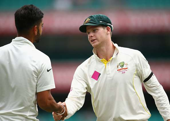 SYDNEY, AUSTRALIA - JANUARY 10: Australian captain Steve Smith shakes hands with Virat Kohli of India after winning the series during day five of the Fourth Test match between Australia and India at Sydney Cricket Ground on January 10, 2015 in Sydney, Australia.  (Photo by Cameron Spencer/Getty Images)