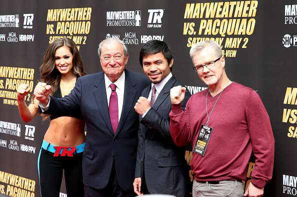 LOS ANGELES, CA - MARCH 11:  (R to L) Trainer Freddie Roach; Manny Pacquiao and promoter Bob Arum pose for the media as they arrive for the Floyd Mayweather v Manny Pacquiao  Press Conference on March 11, 2015 in Los Angeles, California.  (Photo by Stephen Dunn/Getty Images)