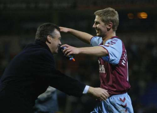 BOLTON, ENGLAND - NOVEMBER 13:  Thomas Hitzlsperger of Aston Villa is congratulated by his manager David O'Leary after the FA Barclays Premiership match between Bolton Wanderers and Aston Villa at the Reebok Stadium on November 13, 2004 in Bolton, England.  (Photo by Gary M. Prior/Getty Images)