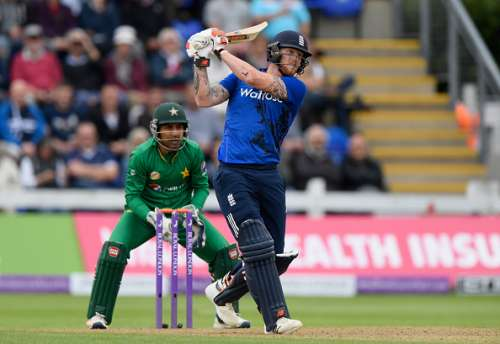CARDIFF, ENGLAND - SEPTEMBER 04:  England player Ben Stokes hits a six watched by wicketkeeper Sarfraz Ahmed during the 5th One Day International between England and Pakistan at Swalec Stadium on September 4, 2016 in Cardiff, Wales.  (Photo by Stu Forster/Getty Images)