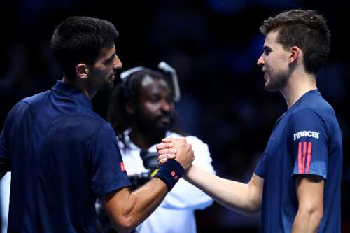 LONDON, ENGLAND - NOVEMBER 13:  Novak Djokovic of Serbia shakes hands with Dominic Thiem of Austria following his victory in their men's singles match on day one of the ATP World Tour Finals at O2 Arena on November 13, 2016 in London, England.  (Photo by Clive Brunskill/Getty Images)