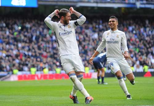 MADRID, SPAIN - JANUARY 21:  Sergio Ramos of Real Madrid celebrates with Henrique Casemiro after scoring his team's 2nd goal during the La Liga match between Real Madrid CF and Malaga CF at the Bernabeu on January 21, 2017 in Madrid, Spain.  (Photo by Denis Doyle/Getty Images)