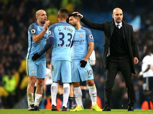MANCHESTER, ENGLAND - JANUARY 21: Pablo Zabaleta of Manchester City (L) and Gabriel Jesus of Manchester City embrace while Josep Guardiola, Manager of Manchester City pats him on the back after the Premier League match between Manchester City and Tottenham Hotspur at the Etihad Stadium on January 21, 2017 in Manchester, England.  (Photo by Alex Livesey/Getty Images)