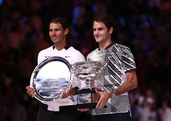 MELBOURNE, AUSTRALIA - JANUARY 29:  Roger Federer of Switzerland poses with the Norman Brookes Challenge Cup after winning the Men