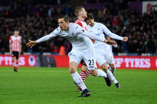 SWANSEA, WALES - JANUARY 31:  Gylfi Sigurdsson of Swansea City celebrates scoring his sides second goal during the Premier League match between Swansea City and Southampton at Liberty Stadium on January 31, 2017 in Swansea, Wales.  (Photo by Stu Forster/Getty Images)