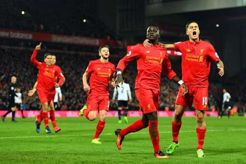 LIVERPOOL, ENGLAND - FEBRUARY 11:  Sadio Mane (2nd R) of Liverpool celebrates scoring his side's second goal with his team mate Philippe Coutinho (1st R) during the Premier League match between Liverpool and Tottenham Hotspur at Anfield on February 11, 2017 in Liverpool, England.  (Photo by Mike Hewitt/Getty Images for Tottenham Hotspur FC)